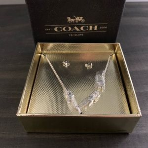 Coach silver earring and necklace set.